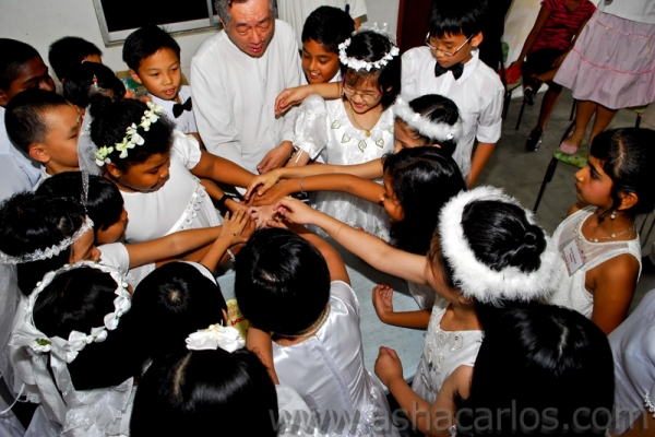 Fr. Joachim - cutting cakes with communicants